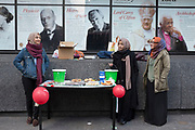 Muslim girls out collecting for charity Islamic Relief in London, UK.