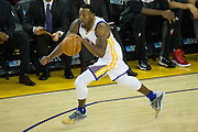 Golden State Warriors forward Andre Iguodala (9) dribbles the ball down the court against the Portland Trail Blazers at Oracle Arena in Oakland, Calif., on October 21, 2016. (Stan Olszewski/Special to S.F. Examiner)