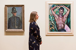 April 3, 2017 - London, London, UK - L to R) Museum staff views a painting titled PC Harry Daley by artist Duncan Grant and a portrait of Pat Nelson by artist Edward Wolfe showing as part of Tate Britain's Queer British Art exhibition. London, UK. (Credit Image: © Ray Tang/London News Pictures via ZUMA Wire)