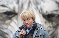 © Licensed to London News Pictures. 02/09/2015. London, UK. Actress Emma Thompson reading a poem outside the Shell Building on the Southbank today with 'Aurora', a large human operated Polar Bear built by Greenpeace activists who intend to picket outside the oil company's headquarters until they abandon plans to drill for oil in the Arctic. Photo credit : James Gourley/LNP