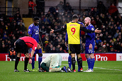 Cardiff City goalkeeper Neil Etheridge kneels injured after a challenge by Watford's Troy Deeney during the Premier League match at Vicarage Road, Watford.