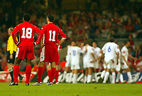Photograph: Scott Heavey.<br />Euro 2004 Group 9 Qualifying match.<br />Wales v Serbia and Montenegro. 11/10/2003.<br />Ryan Giggs and Nathan Blake wait for the ball to be returned after Srbia take a 1-3 lead