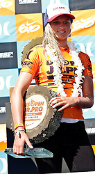 HUNTINGTON BEACH, California/USA (Saturday,Aug 6, 2011)  Lakey Peterson displays her PRO Junior trophy and USD$1,800 check at  the awards ceremony after  winning the Hurley US Open of Surfing PRO Junior.  Photo: Eduardo E. Silva.