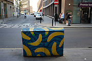 Brightly painted with bananas design, a telecoms junction box in Southwark in South London, United Kingdom. These boxes have started to appear all over the borough as unique street art.