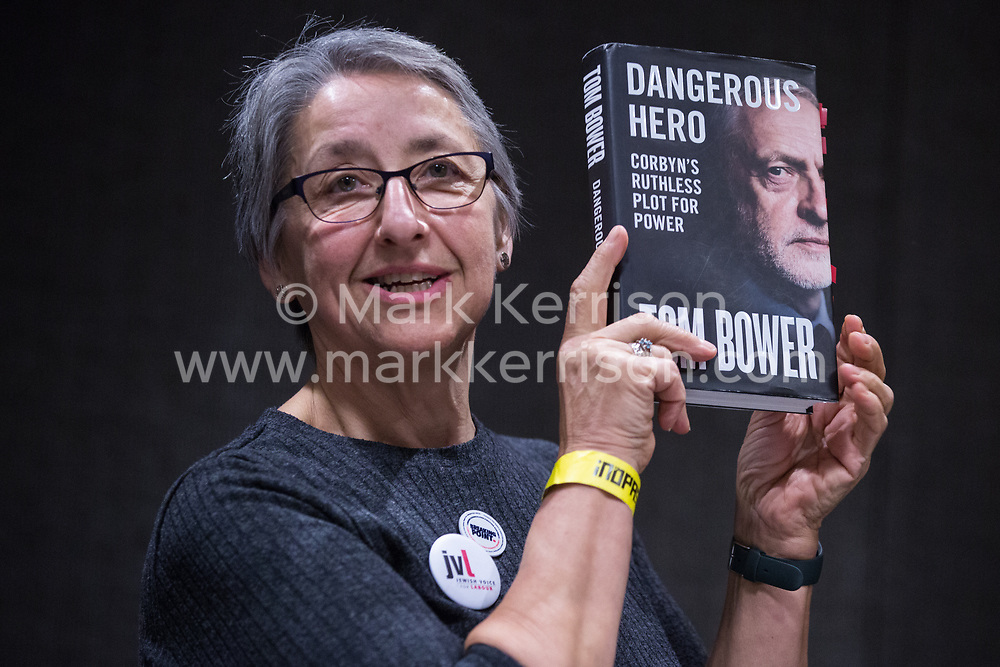 London, UK. 2nd March, 2019. Leah Levane, co-chairwoman of Jewish Voice for Labour (JVL), holds up a book that she has been asked to review as she addresses a workshop titled 'Anti-Semitism: Re-emergence and How It's Being Fought' at the ¡No Pasaran! Confronting the Rise of the Far-Right conference at the Radisson Bloomsbury Street Hotel.