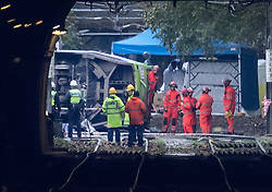 EDITOR'S NOTE: Photograph taken from a public area. © Licensed to London News Pictures. 09/11/2016. London, UK. Emergency workers surround a derailed tram near Sandilands tram station in Croydon, Greater London. Dozens of people are believed to be injured with emergency services saying that there has been a number of fatalities. Photo credit: Peter Macdiarmid/LNP