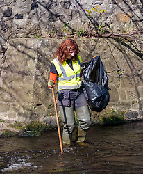 Pictured: Charlotte Neary, Community and Volunteers Officer of Water of Leith Conservation Trust at Water of Leith Spring clean, Edinburgh, Scotland. 31 March 2019. A group of volunteers does an annual Spring clean along a section of the banks of the Water of Leith which runs through Edinburgh, organised by the Water of Leith Conservation Trust. This involves wading across the river to retrieve rubbish.Sally Anderson | EdinburghElitemedia.co.uk<br /> Reproduction fee payable to Edinburgh Elite Media