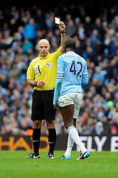 Manchester City's Yaya Toure receives a yellow card. - Photo mandatory by-line: Dougie Allward/JMP - Tel: Mobile: 07966 386802 24/11/2013 - SPORT - Football - Manchester - Etihad Stadium - Manchester City v Tottenham Hotspur - Barclays Premier League