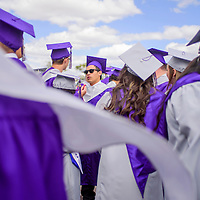 052315       Cable Hoover<br /> <br /> Brandon Cruz, center, and the other class of 2015 graduates gather together in the parking lot of Public School Stadium before the Miyamura High School graduation ceremony Saturday.