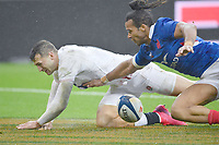 Rugby Union - 2020 Guinness Six Nations Championship - France vs. England<br /> <br /> England's Jonny May scores his sides first try under pressure from Frances's Teddy Thomas, at The Stade de France, Paris.<br /> <br /> COLORSPORT/ASHLEY WESTERN