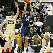 Arsalan Kazemi shoots past Central Florida forward A.J. Tyler (25)during the first half of  a Conference USA NCAA basketball game between the Rice Owls and the Central Florida Knights at the UCF Arena on January 22, 2011 in Orlando, Florida. Rice won the game 57-50 and extended the Knights losing streak to 4 games.  (AP Photo/Alex Menendez)