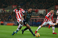 Badou Ndiaye of Stoke City (l) challenges Raheem Sterling of Manchester City. Premier league match, Stoke City v Manchester City at the Bet365 Stadium in Stoke on Trent, Staffs on Monday 12th March 2018.<br /> pic by Andrew Orchard, Andrew Orchard sports photography.