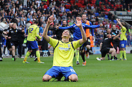 Birmingham's Nikola Zigic leads the celebrations after the game as Birmingham City stay in the Championship next season. Skybet football league championship match , Bolton Wanderers v Birmingham city at the Reebok stadium in Bolton on Saturday 3rd May 2014.<br /> pic by David Richards, Andrew Orchard sports photography.