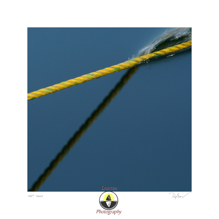 3/20/12 -- HARPSWELL SOUND, HARPSWELL, Maine. Rope cuts clear water. March 2012. .Photo © by Roger S. Duncan 2012..
