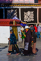 Tibetan pilgrims circumambulate through Barkhor Square and around The Barkhor, Lhasa, Tibet (Xizang), China.