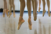 A level eight class jumps into the air during drills at a Pacific Northwest Ballet's summer course. (Ken Lambert / The Seattle Times)
