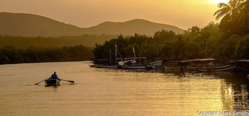 La Boca, Cuba, fishing village, early morning net fishing, boats, cars, flowering trees, people, faces