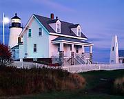Pemaquid Point Lighthouse illuminated at dusk, Maine.