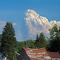 Smoke from a massive forest fire near Yellowstone National Park billows over old ranch buildings in the Gallatin Valley near Bozeman, Montana.