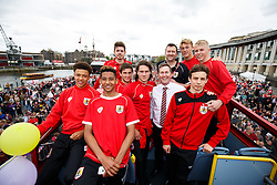The U21 team pose on the bus at Lloyds Amphitheatre during the Bristol City open top bus parade to celebrate winning both the League 1 and Johnstone's Paint Trophy titles this season and promotion to the Championship - Photo mandatory by-line: Rogan Thomson/JMP - 07966 386802 - 04/05/2015 - SPORT - FOOTBALL - Bristol, England - Bristol City Bus Parade.