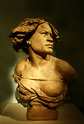 La Negresse.  Cast terracotta.  Atelier of Jean-Baptiste Carpeaux (1827-1875) French, signed and dated 1872.  The bust follows Carpeaux's model of a young African woman, one of the figures representing the four parts of the world that support the globe of the fountain of the observatory in Paris.