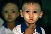 Nusery school<br /> Yangon, Burma. Face covered with Thanaka, a yellowish cosmetic paste made from ground bark which is commonly applied to the face in Burma.
