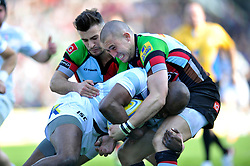 Mike Brown and Danny Care (Harlequins) tackle Topsy Ojo (London Irish) - Photo mandatory by-line: Patrick Khachfe/JMP - Tel: Mobile: 07966 386802 29/03/2014 - SPORT - RUGBY UNION - The Twickenham Stoop, London - Harlequins v London Irish - Aviva Premiership.