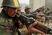 Afghan National Army recruits practice urban warfare training at the KMTC (Kabul Military Training Center) with mentoring by American and members of the 41 nation International Security Assistance Force (ISAF) coalition.  Most training is done by officers from the Afghan Army.  As of November 2008 the ANA was 68,000 soldiers strong and projected to reach 134,000 by 2012.  CSTC-A and the Kabul Military Training Institute continue to churn out a 1,200 battalion of soldiers every two weeks.