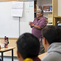 Johnny Harvey starts class off with a few examples for mode linguistics in the Navajo Language at the Rehoboth Christian High School in Rehoboth, New Mexico.