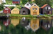 Traditional boat houses at Totlandsvik, Osteröy (Vestland, Norway) in July.