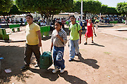 26 JULY 2004 -- TAPACHULA, CHIAPAS, MEXICO:  People in Tecun Uman, Guatemala, on the Rio Suchiate, which is the border between Mexico and Guatemala, wait to enter Mexico illegally on their way to the US. They plan to catch a freight train in Tapachula to ride north to Mexico City. Tapachula is center of the smuggling industry between Mexico and Guatemala. Consumer goods are smuggled south to Guatemala (to avoid paying Guatemalan import duties) and people are smuggled north into Mexico. Most of the people coming north are hoping to eventually get to the United States.PHOTO BY JACK KURTZ