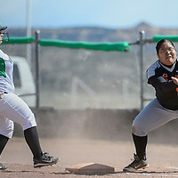 Farmington Scorpion Kenna Colebrook (42) makes it back to first base before Gallup Bengal Nicole Pablo (15) can tag her out for attempting to steal second during the game at Gallup High School Friday.