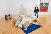 Tracey Emin with My Bed 1998, in front of six of her recent figure drawings which have been gifted by the artist to the nation. My Bed 1998 became famous when it was shown in the 1999 Turner Prize exhibition, for which Emin was shortlisted. It was made in Tracey Emin's Waterloo council flat in 1998 and was referred to by the artist as an unconventional and uncompromising self-portrait through objects - featuring the artist's own bed covered in stained sheets, discarded condoms, underwear and empty bottles of alcohol. The piece gives a snapshot of the artist's life after a traumatic relationship breakdown. The Duerckheim Collection acquired the work in early July 2014 and it is now on loan to Tate for 10 years. <br /> <br /> The drawings and My Bed are positioned alongside two paintings by Francis Bacon, Study of a Dog 1952 and Reclining Woman 1961. And are part of a refresh of the galleries showing art from the 1970s to the present day - featuring major works by Gilbert & George, Anish Kapoor, Nicholas Pope and John Gerrard.