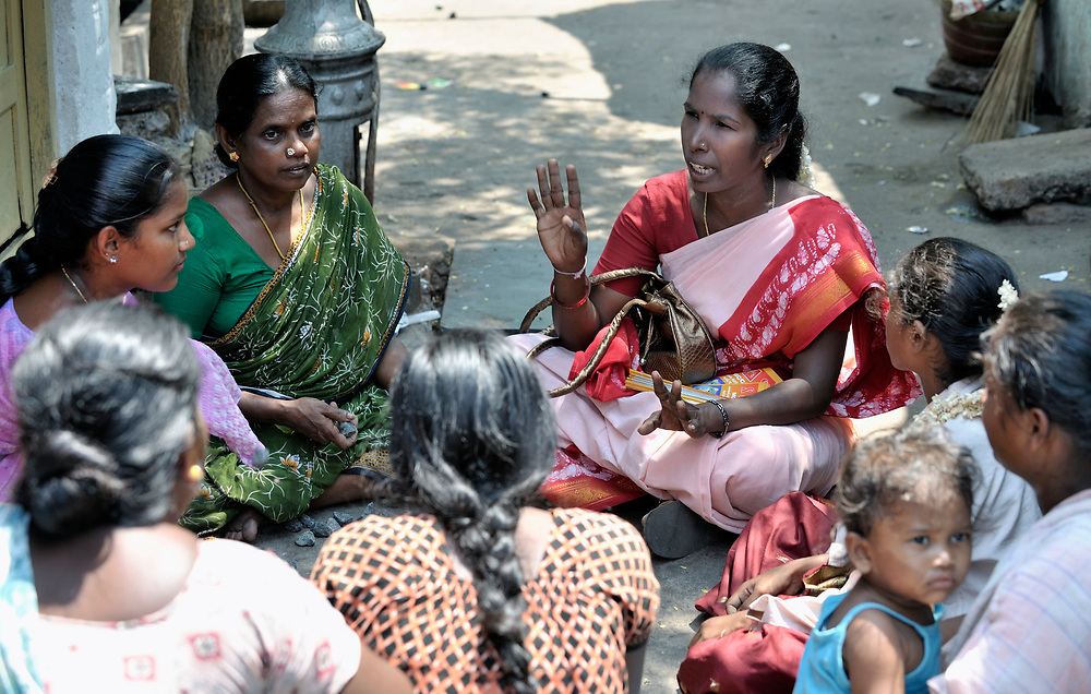 Sagayayeselvi, an educator with the Madras Christian Council of Social Service, talks with a group of residents of a slum in Chennai, India, about HIV and AIDS and how HIV is transmitted.