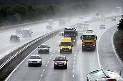 © Licensed to London News Pictures. 09/09/2013<br /> M25 bad weather.<br /> Drivers brave the very wet and dangerous driving conditions this late afternoon (09.09.2013) at the start of the Monday night communte home on the M25 at Junction 3 for Swanley in Kent.<br /> Photo credit :Grant Falvey/LNP