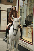 To celebrate the launch of the new Swaine Adeney Brigg store  model and up and coming actress Laurella Fox-Pitt on a horse wearing only a pair of Swaine Adeney's riding boots. St. James's St. London. 4 September 2006. ONE TIME USE ONLY - DO NOT ARCHIVE  © Copyright Photograph by Dafydd Jones 66 Stockwell Park Rd. London SW9 0DA Tel 020 7733 0108 www.dafjones.com