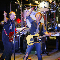 (PMONMOUTH) Asbury Park 12/5/2003  Bruce Springsteen and the Max Weinberg band perform at the Christmas Show. To the rear is Max Weinberg and Left is lead guitar Jimmy Bibino.    Michael J. Treola Staff Photographer......MJT