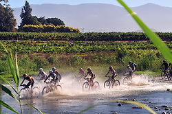 ROBERTSON, SOUTH AFRICA - MARCH 20: The UCI Elite Women cross the Breede river during stage two's 110km from Robertson on March 20, 2018 in Cape Town, South Africa. Mountain bikers from across South Africa and internationally gather to compete in the 2018 ABSA Cape Epic, racing 8 days and 658km across the Western Cape with an accumulated 13 530m of climbing ascent, often referred to as the 'untamed race' the Cape Epic is said to be the toughest mountain bike event in the world. (Photo by Dino Lloyd)