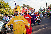 """Dec. 12, 2009 -- PHOENIX, AZ: Matachines perform during a procession to honor the Virgin of Guadalupe at St. Catherine of Siena Catholic Church in Phoenix, AZ. Most of the members of the church are Hispanic and Dec. 12, Virgin of Guadalupe Day, is one of the church's most important holy days. The Virgin of Guadalupe appeared to Juan Diego, a Mexican peasant, on Dec 9, 1531, on a hillside near Mexico City. She is the """"Queen of Mexico"""" and """"Empress of the Americas"""" and revered throughout Latin America. Matachine dancers, common in northern Mexico and Mexican-American communities in the US, dance on important religious holidays to honor and venerate God.  Photo by Jack Kurtz"""