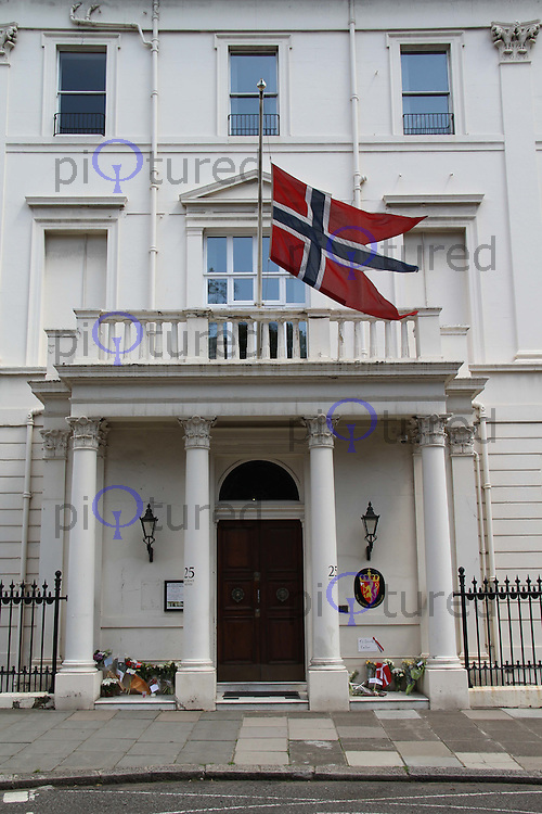 The Norwegian Flag flies at half mast in tribute to the massacred youths killed by Anders Behring Breivik on the island of Utoeya and the bombing in Oslo. Embassy of Norway, Belgrave Place, London, UK, 24 July 2011:  Contact: Rich@Piqtured.com +44(0)7941 079620 (Picture by Richard Goldschmidt)