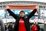 A Liverpool fan outside the stadium prior to kick off. Capital One Cup Final, Liverpool v Manchester City at Wembley stadium in London, England on Sunday 28th Feb 2016. pic by Chris Stading, Andrew Orchard sports photography.