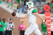 Marshall Thundering Herd quarterback Chase Litton (1) rushes for a 6 yard touchdown against the North Texas Mean Green during the 1st half at Apogee Stadium in Denton, Texas on October 8, 2016. (Cooper Neill for The Herald-Dispatch)