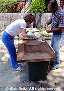 Active Aging Senior Citizens, Retired, Activities, Retired Couple Work on Home Project, Clean and Paint Door