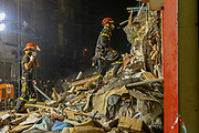 Lebanese and Chilean rescue workers work through the night on Friday 4 August, 2020 to save the life of someone they have found trapped in the rubble of a building destroyed by the Beirut Port explosion in August. (VXP Pictures/ Matt Kynaston)