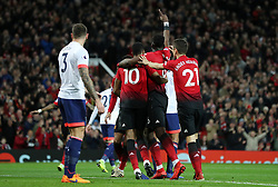 Manchester United's Paul Pogba (centre) celebrates scoring his side's first goal of the game during the Premier League match at Old Trafford, Manchester.