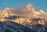 From left to right is Middle Teton, Grand Teton, and Mount Owen. There were just enough clouds at sunrise to make for a good time lapse.