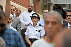 Metropolitan Police Commissioner Cressida Dick joins members of the public as they gather close to Finsbury Park Mosque in north London, after a van was driven into pedestrians near the north London mosque, leaving one man dead and eight injured.