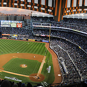 A panoramic view of Yankee Stadium as the late evening sunshine catches the Yankee Stadium facade during the New York Yankees V Baltimore Orioles American League Division Series play-off decider at Yankee Stadium, The Bronx, New York. 12th October 2012. Photo Tim Clayton.Note to Editors. This image is a composite of two images taken a split second apart and merged in editing.