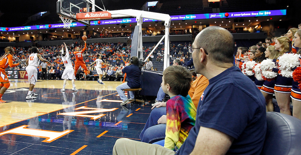 Virginia fans watch as Clemson guard Chancie Dunn (23) shoots the ball during the game Sunday in Charlottesville, VA. Photo/The Daily Progress/Andrew Shurtleff