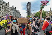 "People take part in a ""Black Trans Lives Matter"" protest in Central London on Saturday, June 27, 2020.<br /> The Black Trans Lives Matter march was held to support and celebrate the Black transgender community and to protest against potential amendments to the gender recognition act. (Photo/ Vudi Xhymshiti)"